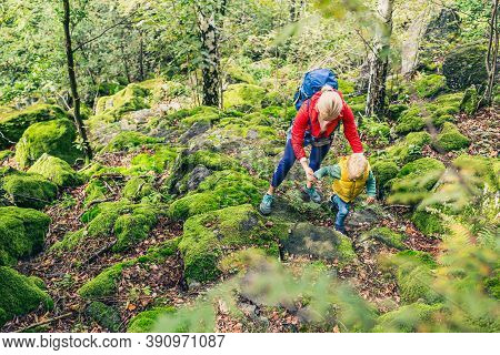 Little Boy Hiking With Mother, Family Adventure. Child Walking In Rocky Green Forest, Physical Activ