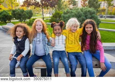 Moments. Interracial Group Of Kids, Girls And Boys Playing Together At The Park In Summer Day. Frien