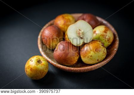 Fresh Chinese Jujube In A Plate On Black Background