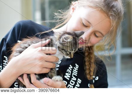 Moscow. Russia. August 2020. Happy Girl Adopted A Cat From Shelter. Kitten As A Birthday Present For
