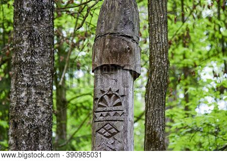 Image Of The Slavic Goddess Makosh Carved From A Tree Trunk On A Neo-pagan Temple In The Forest. Kal