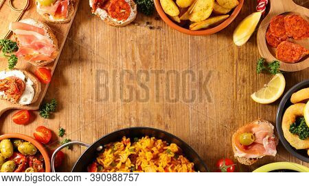 spanish food- tapas, paella, olive, chorizo and fried onion