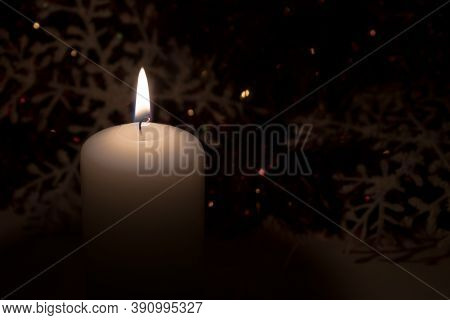 Christmas Background. Christmas Burning Candle On A Dark Background