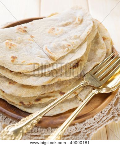 India vegetarian food plain chapatti roti or Flat bread. Indian food on dining table. poster