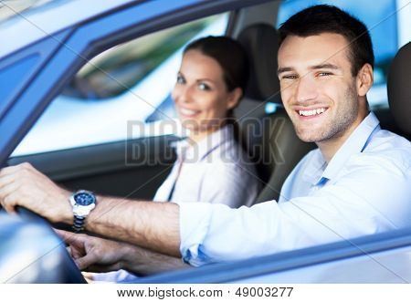 Happy couple in the car