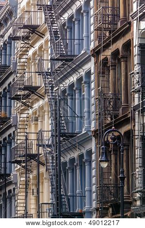 Four painted cast iron 19th century facades in Manhattan's Soho neigborhood New York City. poster