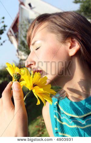 Smelling At Flower
