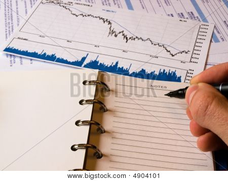 Falling Finance Graph & A Notepad