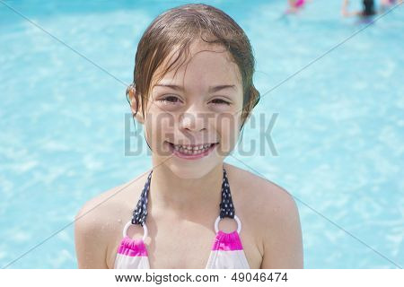 Cute little swimmer girl just getting out of the swimming pool
