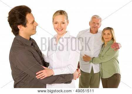 Husband Wife Father In Law Mother In Law Standing On White Background