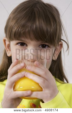 Little Cute Smiling Girl Seven Years Old Drink