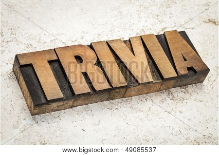 trivia word in vintage letterpress wood type on a ceramic tile background