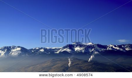 Mountains And Geysers