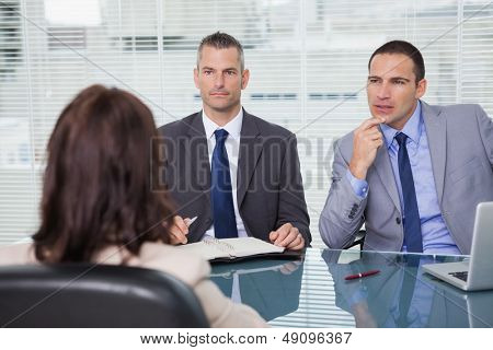 Serious businessmen having an interview in bright office