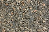 Detail of asphalt road surface as texture close-up poster