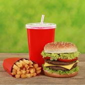 Double Cheeseburger combo meal with french fries and a cola drink poster