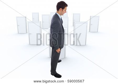 Cheerful businessman standing with hands on hips against many doors closed shut with one opening