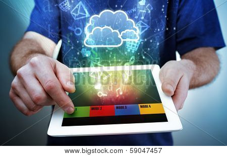 Digital tablet with multimedia, e-mail, e-commerce and social media icons flying out of the screen concept for cloud computing, mobility and internet