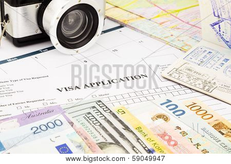 Visa Application Form, Passport, World Currency And Banknotes