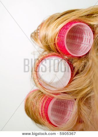 Red Curlers In Blond Hair
