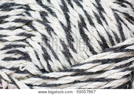 skein of yarn black and white melange closeup poster