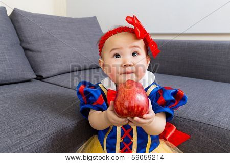Asian baby holding apple