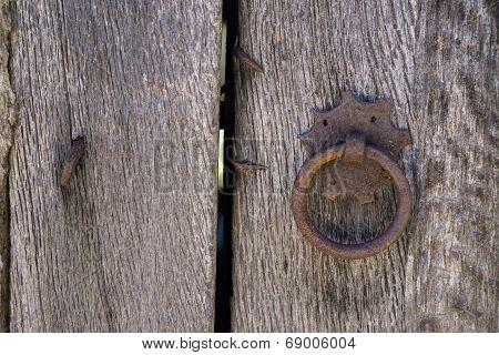Old doorknocker and door