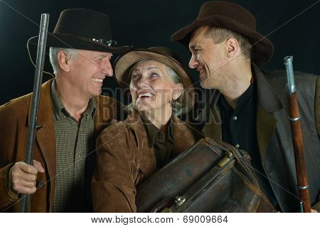 Three bandits with guns