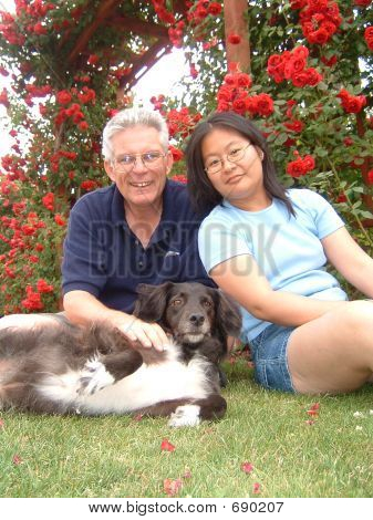family vacation picture: me, my hubby and my dog in a rose garden, dog is in supreme relaxation....  :) poster