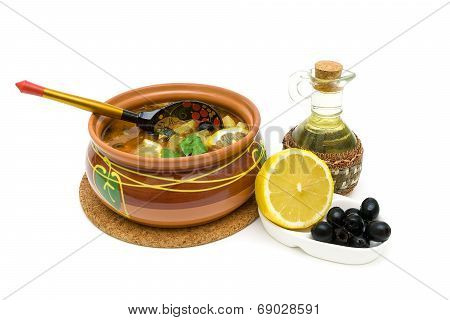 Dish Of Russian Hodgepodge Soup In Ceramic Pot On White Background