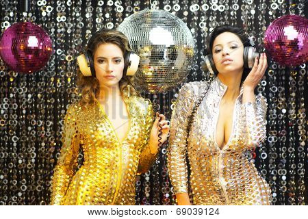 Two Beautiful Sexy Disco Women In Gold And Silver Catsuits Dancing