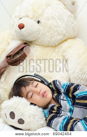 Little Boy Listening The Music With Headset While Sleeping