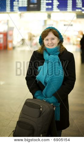 Beautiful Smiling Woman In The Airport