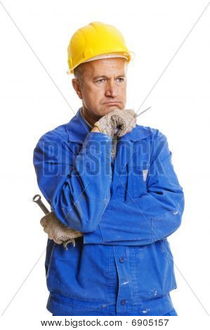 Thoughtful Workman With Tools