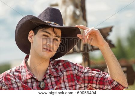Cowboy on sign background.