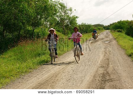 Children Riding Bike On Country Road