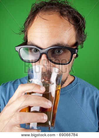 Thirty Year Old Man With 3D Glasses Drinking While Watching A Movie