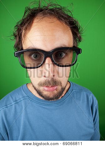 Thirty Year Old Man With 3D Glasses Watching A Sad Movie