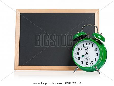 Big green alarm clock with blackboard, isolated on white background