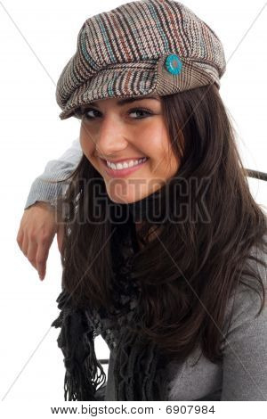 Young Woman In Cap Smile And Turn Back