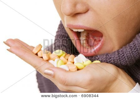Woman Taking Pills Over White