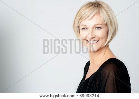 Smiling Woman On A Grey Background