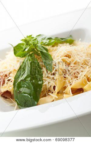 Traditional Fettucine alla Carbonara with Basil Leaf
