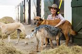 cheerful horse stables owner and dogs indoors poster