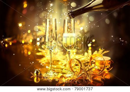 New Year celebration with champagne. Champagne Christmas and New Year celebration. New Year holiday decorated table. Two Champagne Glasses