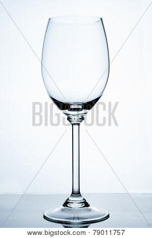 Empty wine glass isolated om white background.