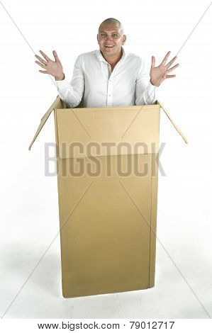 Man packed in a cardboard box isolated on a white background poster