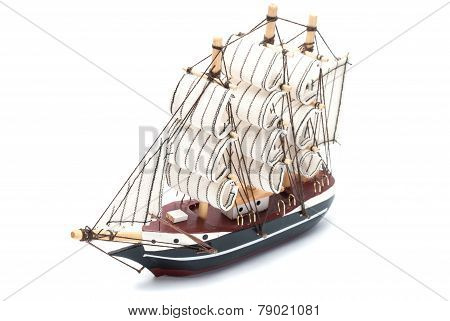 Small model ship isolated on white background.
