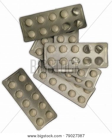 heap of medicine pills blister packs on a white background