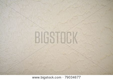 Fragment of the wall with decorative plaster close up